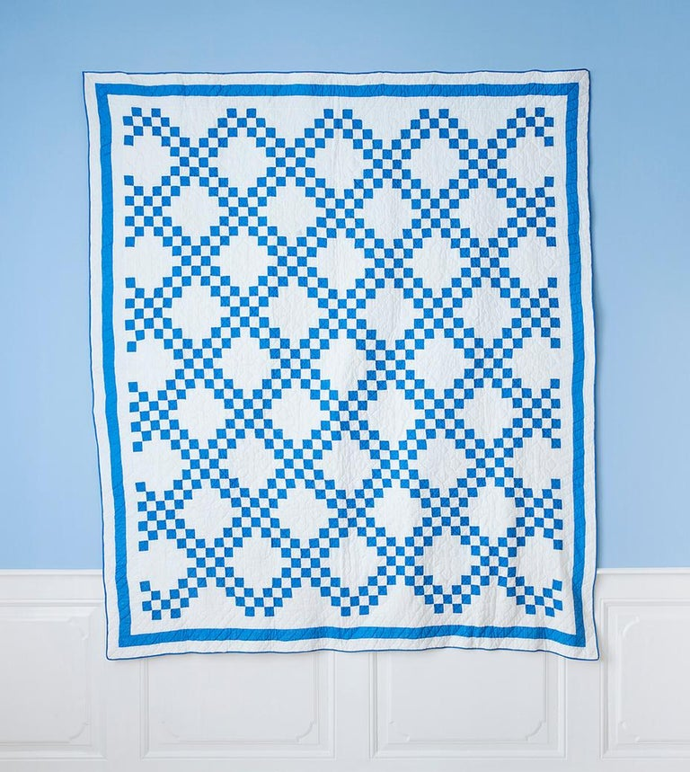Blue and white 'Double Irish Chain' quilt,  USA, 1920s  Measures: H 212 x W 183 cm.