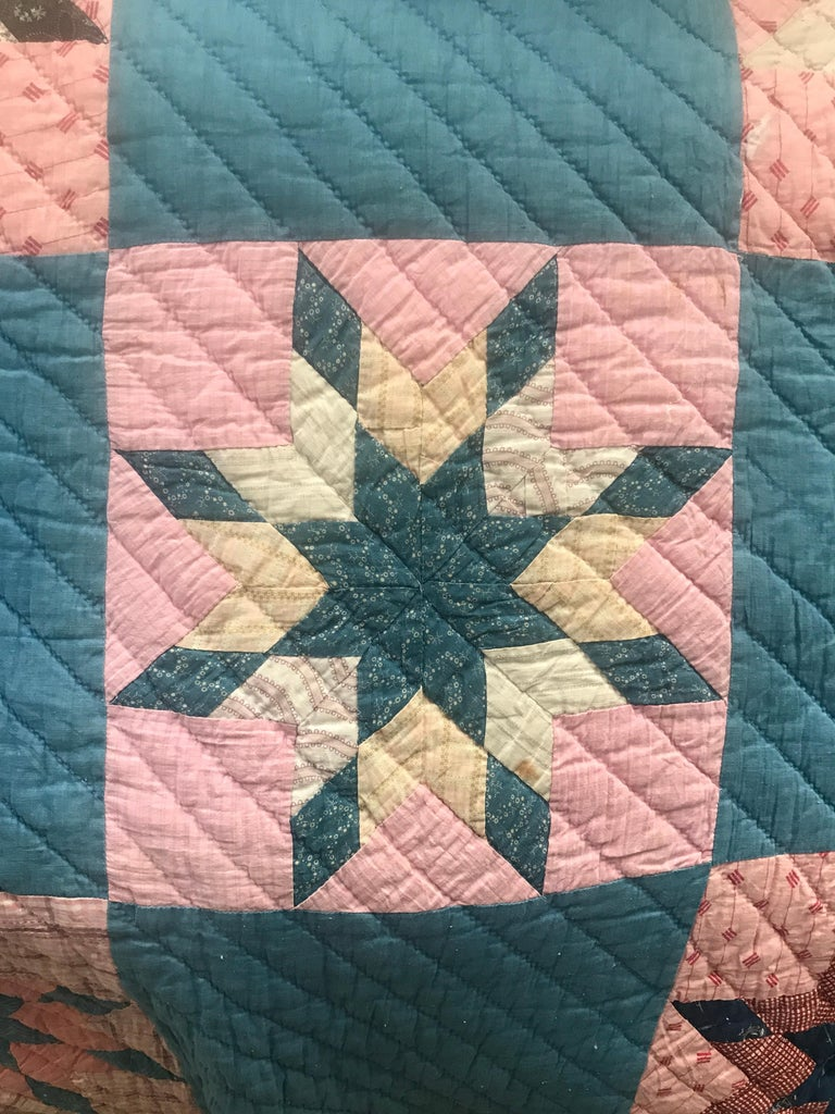Lovely vintage 'star compass' quilt.