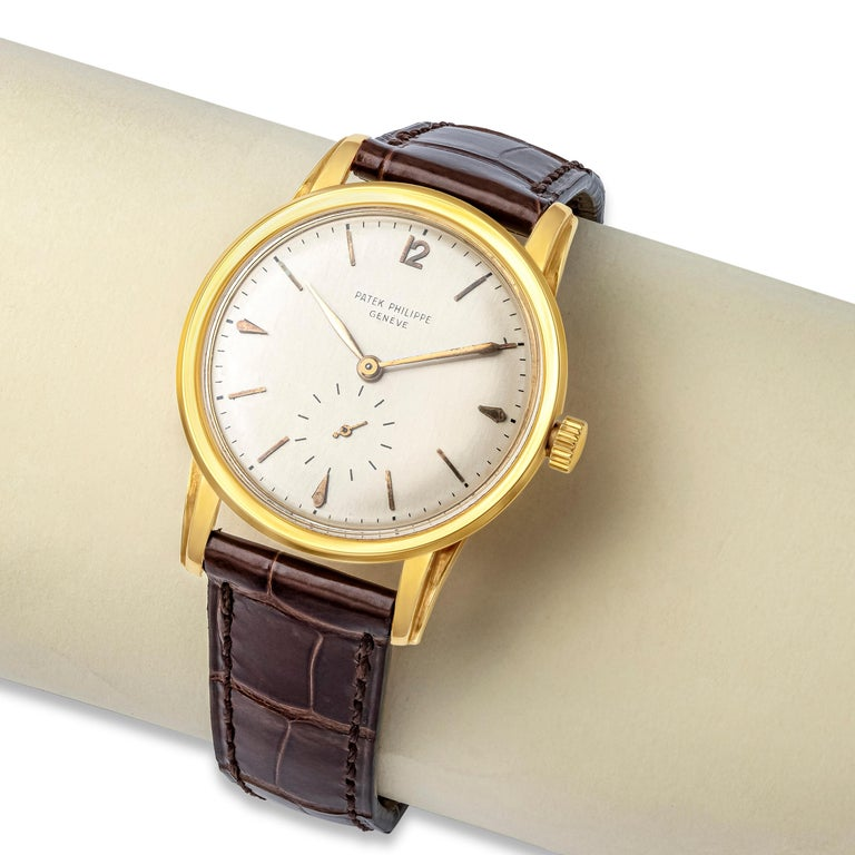 A vintage and classic Patek Philippe watch. Calatrava model. 35mm case diameter made in 18k yellow gold. Ref 2452J with a 10-200 Caliber Movement. This movement was fitted to this model watch made in 1949 - 1951. Silver white dial with gold hour