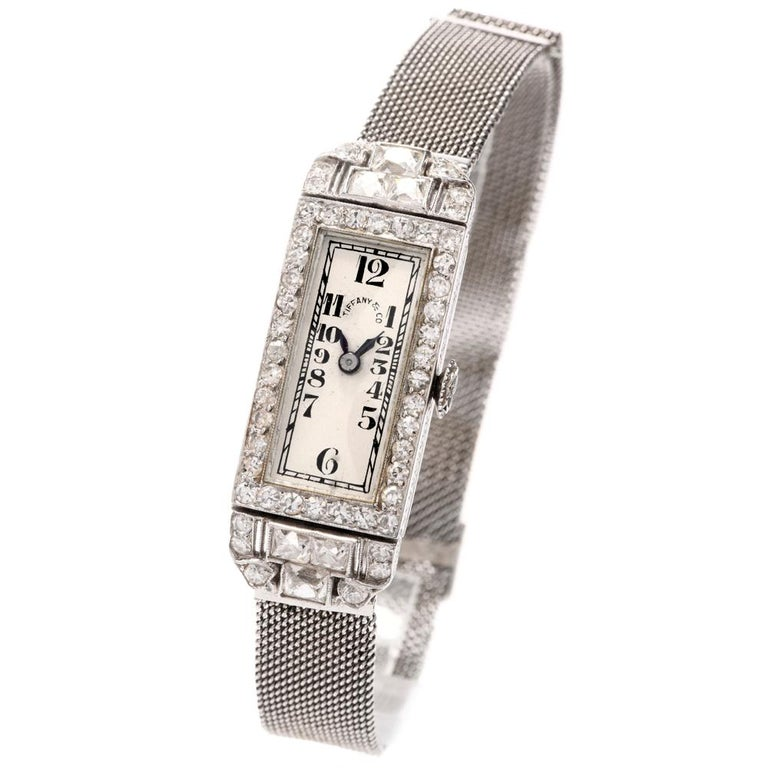 Make your mark with this rare vintage    timeless fashion icon Patek Philippe   Ladies diamond watch.  Crafted in sensual 25.5 grams of platinum,   This mesh link flexible watch was created exclusively for Tiffany and Co.  and offers  Extreme