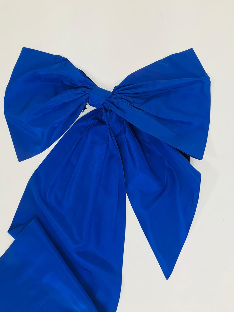 Vintage Patrick Kelly, Paris big blue taffeta bow from the 1980s. This amusing  piece will be a perfect addition to a dress, skirt, cape, coat or a hair accessory for anyone with as much imagination and whimsy as it's creator!   A bow that is
