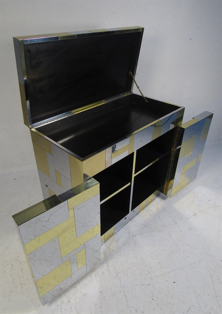Beautiful signed Mid-Century Modern bar cabinet by Paul Evans for Directional. A wonderful patchwork design with a flip top and two cabinet doors below. Sleek case piece that looks great in any home, business, or office. Pe 200 series. Please