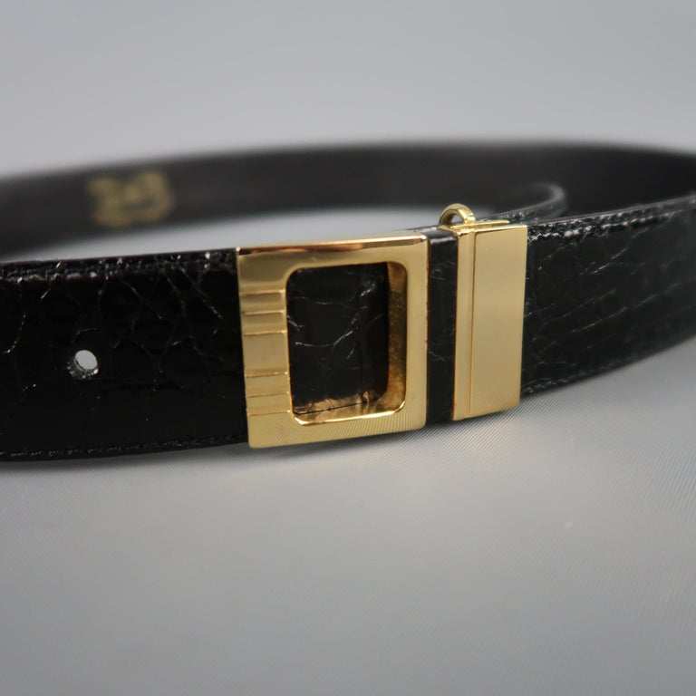 Vintage P&B dress belt features a black alligator textured patent leather strap with a gold tone cutout buckle. Made in Italy.   Excellent Pre-Owned Condition. Marked: 75/30   Length: 36.25 in. Width: 1 in. Fits: 28.5-32.5 in.
