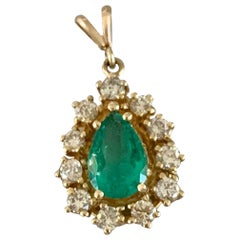 Vintage Pear Shaped Emerald and Diamond Halo 14 Karat Yellow Gold Pendant