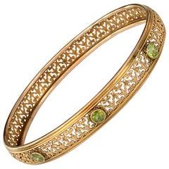 Vintage Peridot 14 Karat Yellow Gold Bangle Bracelet