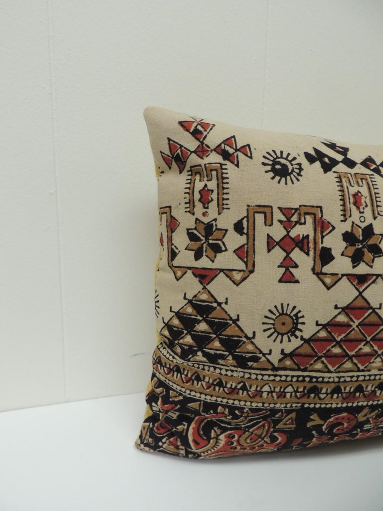 Vintage Persian hand-blocked Kalamkari artisanal textile throw pillows with a pattern that is a floral and stripes with geometrical accents on the vintage Persian decorative pillow. Throw lumbar pillow in shades of red, black, camel, brown and