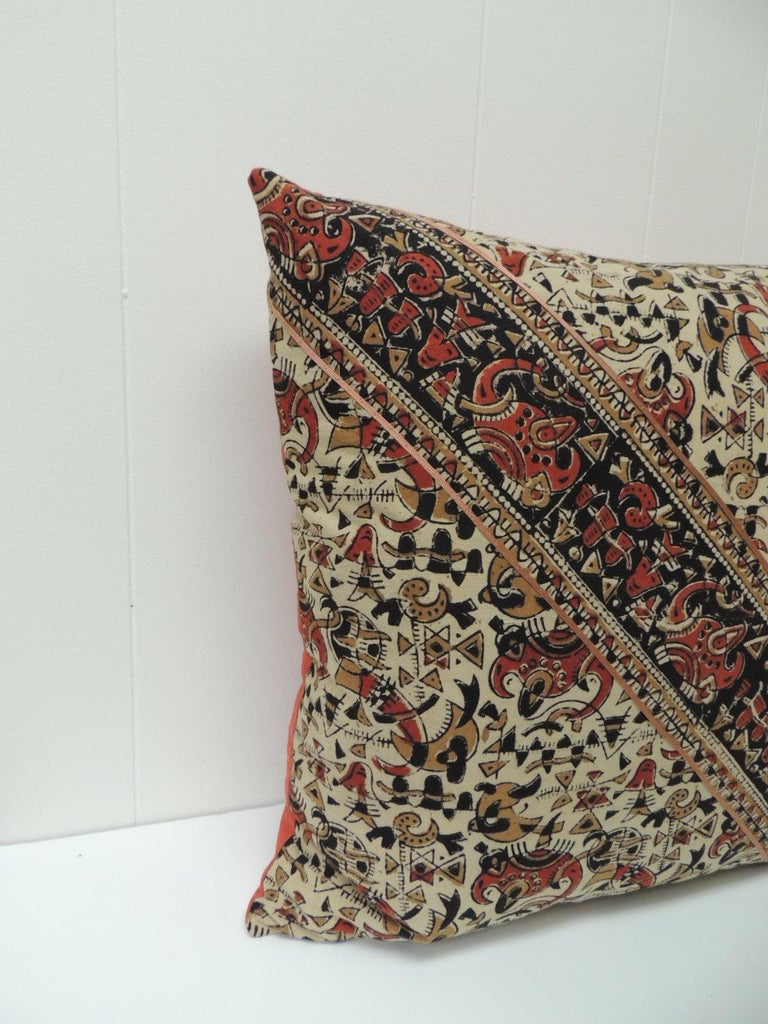Vintage Persian hand-blocked artisanal Kalamkari textile in the front of the square throw pillow with diagonal stripe to create a mirrored image. Decorative textile pattern is floral with stripes and with geometrical accents on the vintage throw