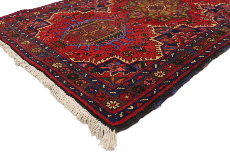 60243 Vintage Persian Heriz Karaja Runner with with Tribal Art Deco Style. This hand-knotted wool vintage Persian Heriz Karaja carpet runner features latch hook medallions and amulets surrounded by an all-over geometric pattern composed of tribal