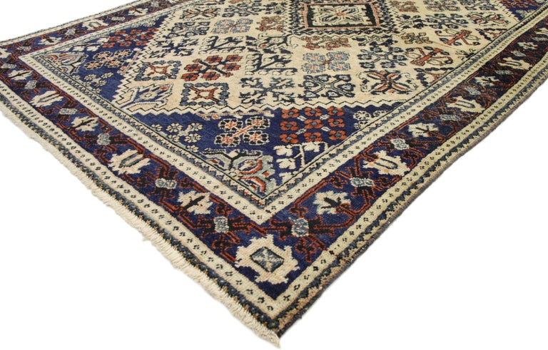 75217, vintage Persian Joshegan rug. With brilliant blues and warm beige colors inspired by Italy combined with modern and rustic, this hand knotted Persian Joshegan rug is well-balanced and poised to impress. It features a central lozenge medallion
