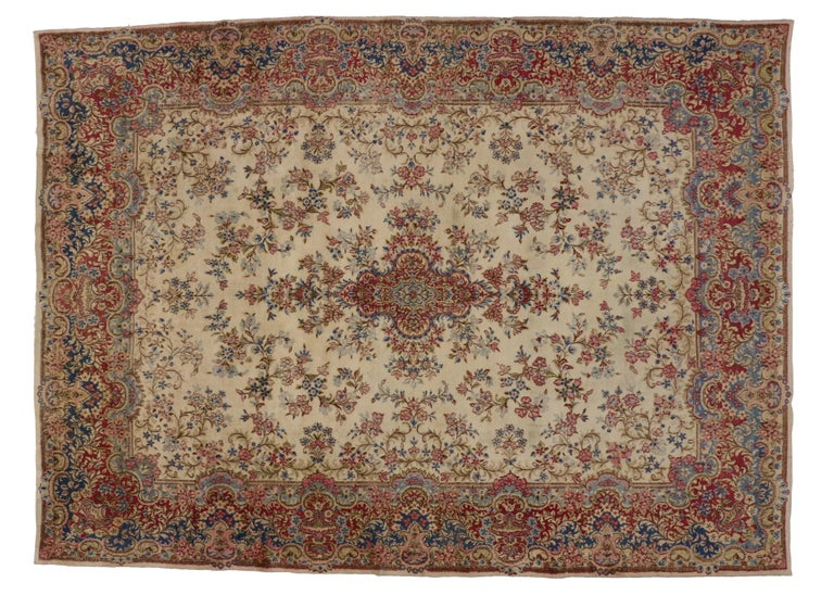 74920, vintage Persian Kirman rug with Rococo style, Kerman Area. This hand-knotted wool vintage Persian rug features a Classic Kerman Medallion design composed of delicate flowers in a creamy beige field surrounded by an abundance of florals and