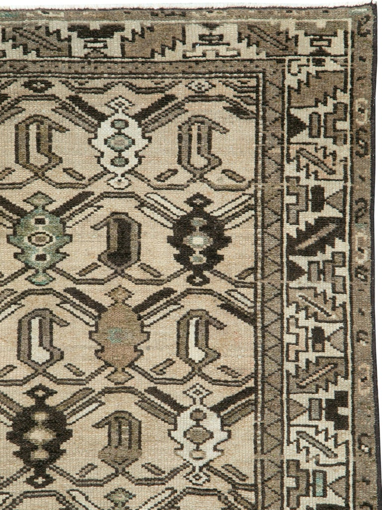 A vintage Persian Malayer rug from the mid-20th century.  Measures: 3' 11