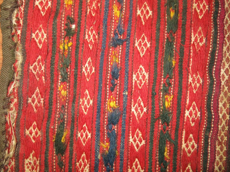 A vintage Persian Kilim scatter sofreh flat-weave from the mid-20th century.  Sofrehs are woven by Persian tribes as part of the dowry, used as floor spreads on which they would offer food for special guests. Their diminutive size and their