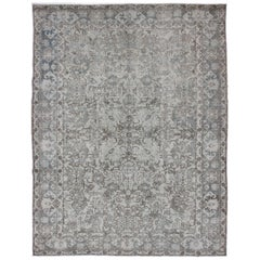 Vintage Persian Tabriz Distressed Rug with Muted, Ornate All-Over Floral Design