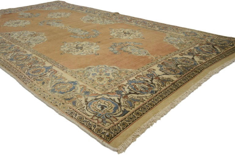 75204 Vintage Persian Tabriz rug with Swedish Farmhouse Style 04'00 X 07'07. This hand-knotted wool vintage Tabriz rug features beautiful vase motifs along the center of an abrashed field surrounded by four scalloped floral medallions. Elaborate
