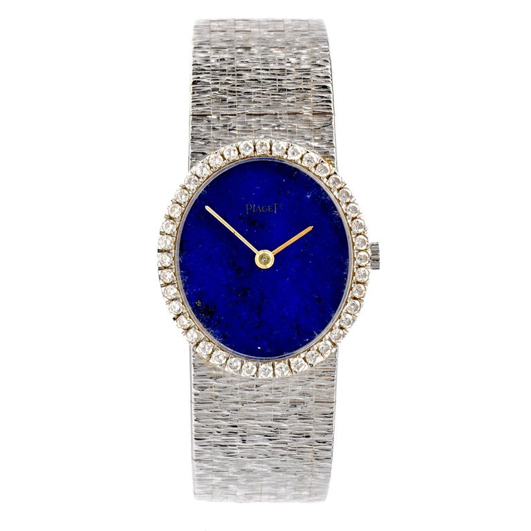 Circa Late 1960's designer Piaget ladies watch crafted in solid 18-karat white gold.   Embellished with factory set diamond. Sapphire Crystal, Genuine lapis Dial, 24mm case( without Crown) and 36 factory set round diamonds approx. 0.75 carats, E-F
