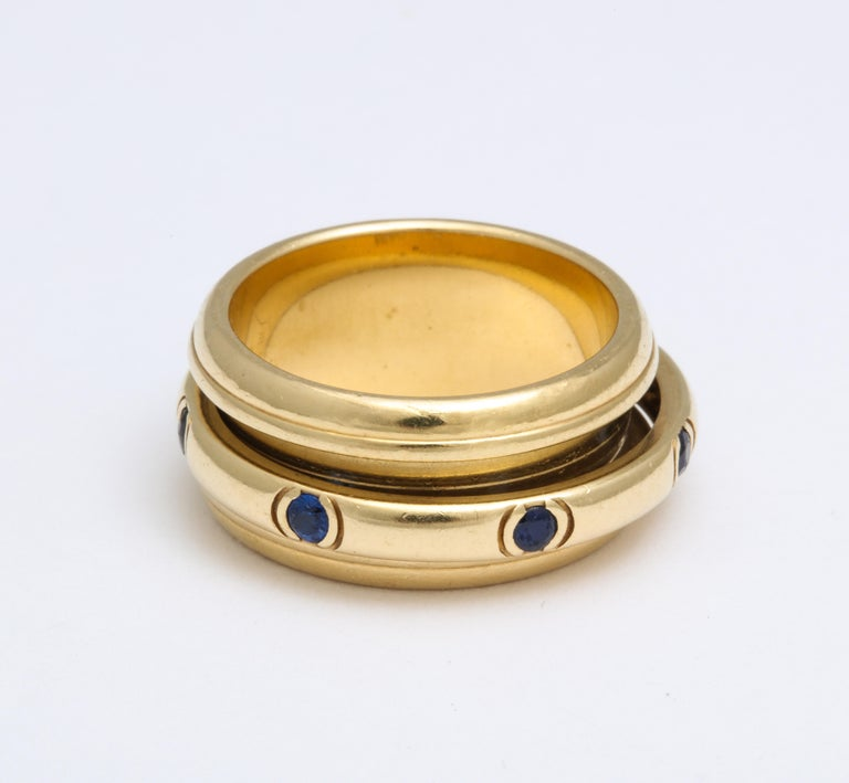 Modern Vintage French  Piaget Sapphire and 18 Karat Gold Fidget Ring For Sale