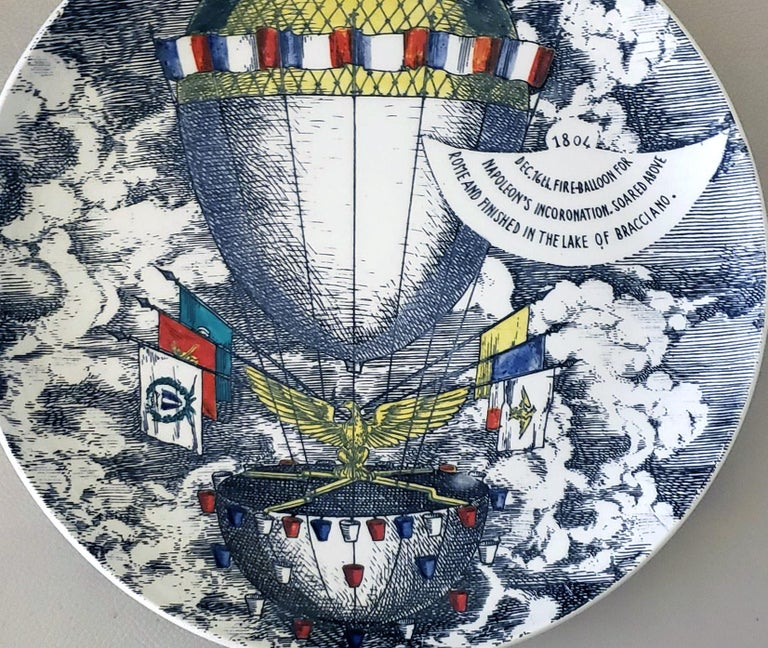 Vintage Piero Fornasetti Plate, Mongolfiere (hot air) Design, 1804/ Dec. 16 fire-balloon for/Napoleon's Incoronation, soared above/ Rome and Finish up in the Lake of Bracciano. 1950s    The large Piero Fornasetti plate depicts a large hot air