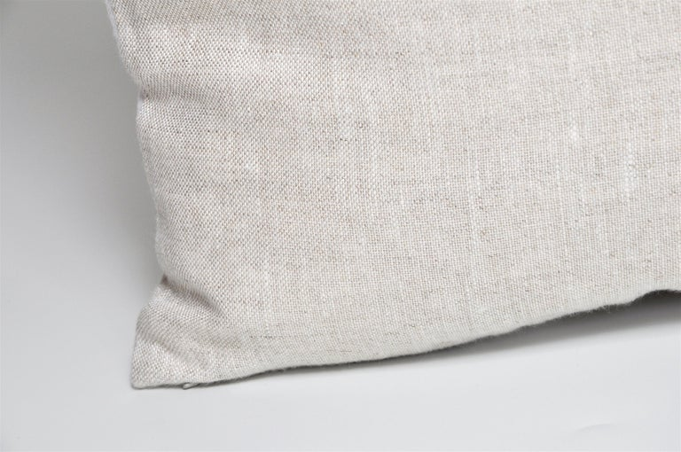 This cushion is a one-of-a-kind and part of a sustainability project. It has been created from an up-cycled, recycled luxury fabric, used with the intentions of promoting a more eco-friendly environment by using already existing materials. We both