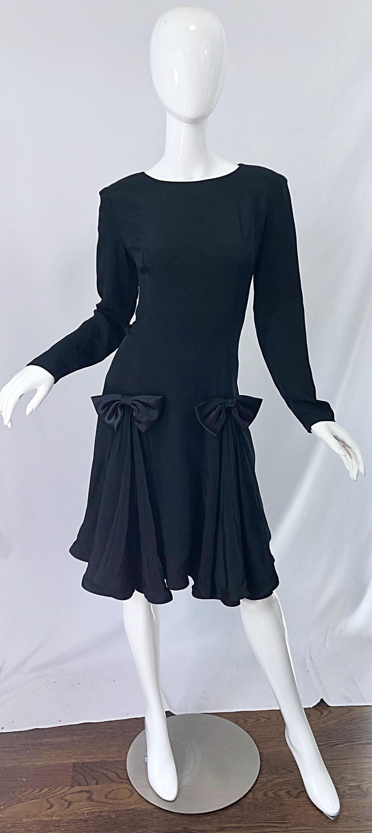 Timeless vintage early 90s PIERRE CARDIN black silk long sleeve bow dress ! Features a tailored bodice with a forgiving full pleated skirt. Hidden zipper up the back with hook-and-eye closure. The perfect little black dress that is great for any