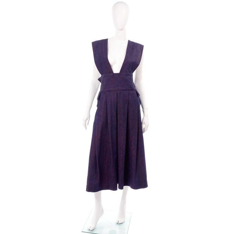 We acquired  this vintage 1980's dress when we bought the entire estate of a woman who had a huge collection of vintage Issey Miyake, Comme des Garcons and Yohji Yamamoto. She told us that she removed the label but knew that she got it in Japan from