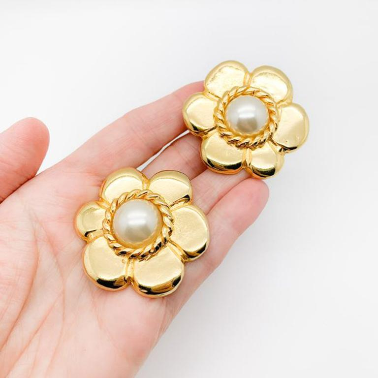 Vintage Pinky Paris Flower Earrings. Striking Parisian clip on earrings with a glamorous flower power feel. Featuring high quality gold plated metal with a central simulated half pearl. Signed, in very good vintage condition, 4.5cm. A stunning pair