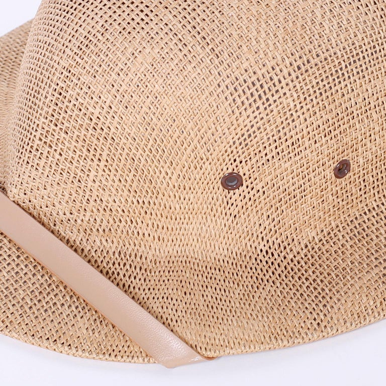 Dashing iconic pith helmet with breather holes, adjustable leather headband, and a vintage Palm Beach label, apparently never worn.