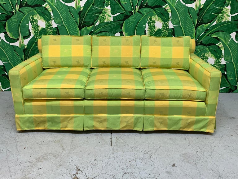 Vintage green and yellow plaid sofa in the manner of Dorothy Draper. Cheerful and fun print that will add a bright touch to any decor. Very good condition structurally and cosmetically with no stains or tears to fabric.