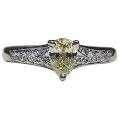 Vintage Platinum .71 Carat Fancy Light Yellow Pear Diamond Engagement Ring