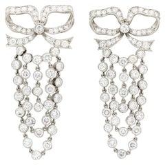 Vintage Platinum and 10 Carat Diamond Bow Drop Chandelier Earrings