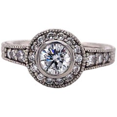 Vintage Platinum and .83 Carat Diamond Halo Engagement Ring