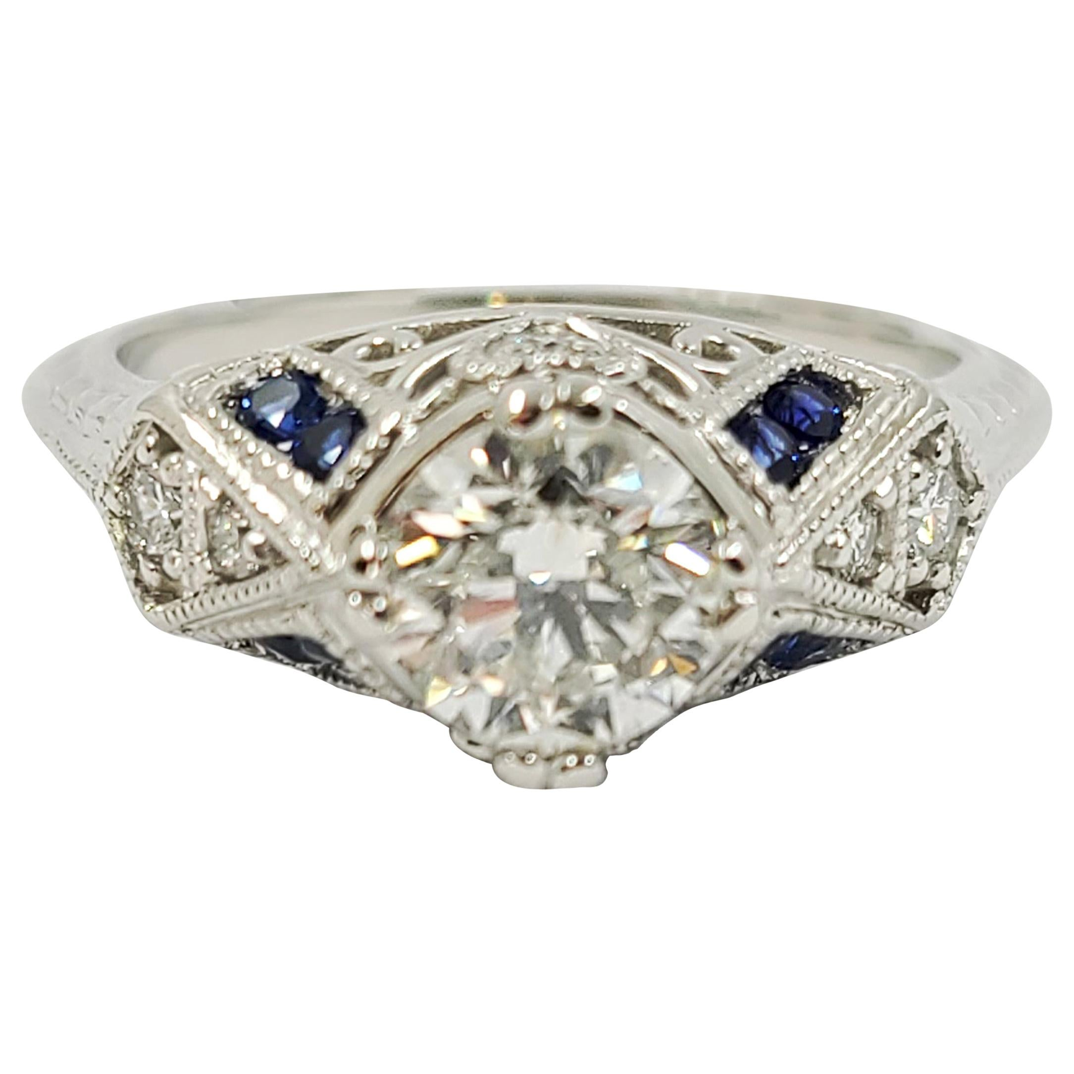 Vintage Platinum Diamond Engagement Ring with Sapphire Accents