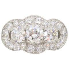 Vintage Platinum Diamond Three-Stone Halo Ring