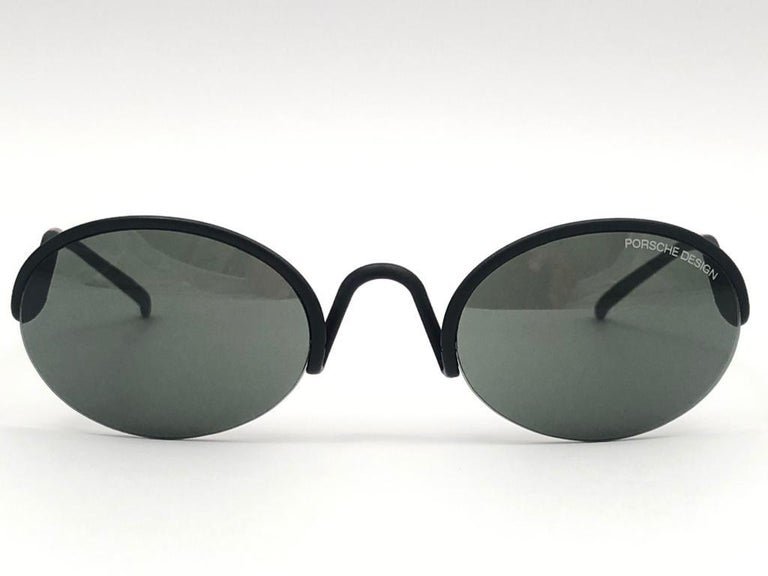 Collectors item from the 1990's, 20 years old.   Porsche Design small oval frame black matte frame lenses.   Amazing craftsmanship and quality. This pair has light of wear due to storage.  Made in Austria.  MEASUREMENTS   FRONT : 13.5  LENS HEIGHT :