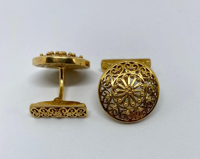 Spectacular vintage cufflinks made in Portugal, where the gold standard is higher than the rest of Europe, at .800 or 19.2 karat.  The workmanship is outstanding. The cufflinks feature openwork circles backed with matching openwork fasteners. Small