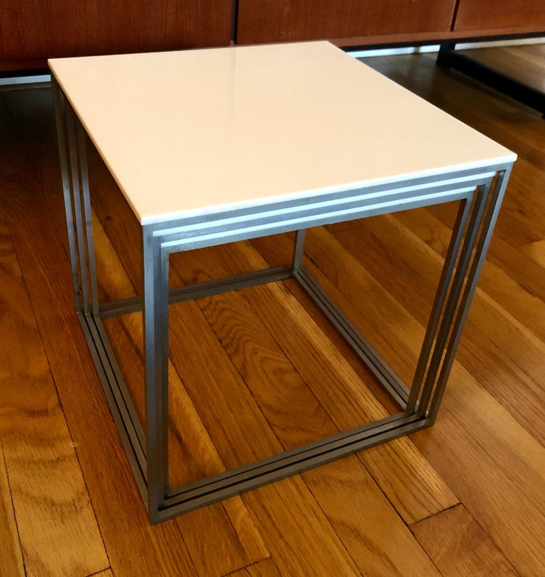 Poul Kjaerholm PK 71 nesting tables, set of three, for E. Kold Christensen, Denmark, circa 1957, matte chrome-plated steel, with white acrylic tops, measures 11 W x 11 D x 11 H inches.