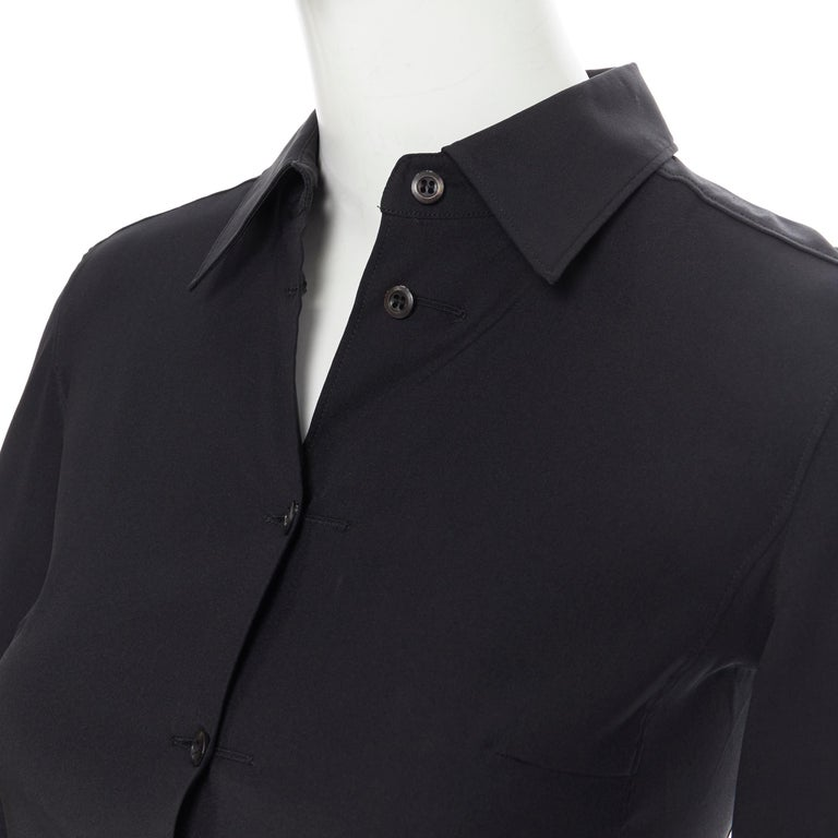 vintage PRADA black silk blend button front cropped 3/4 sleeve shirt top IT38 XS Brand: Prada Model Name / Style: Crop top Material: Silk, blend Color: Black Pattern: Solid Closure: Button Extra Detail: Bust dart. 3/4 sleeve. Short bodice fit. Made