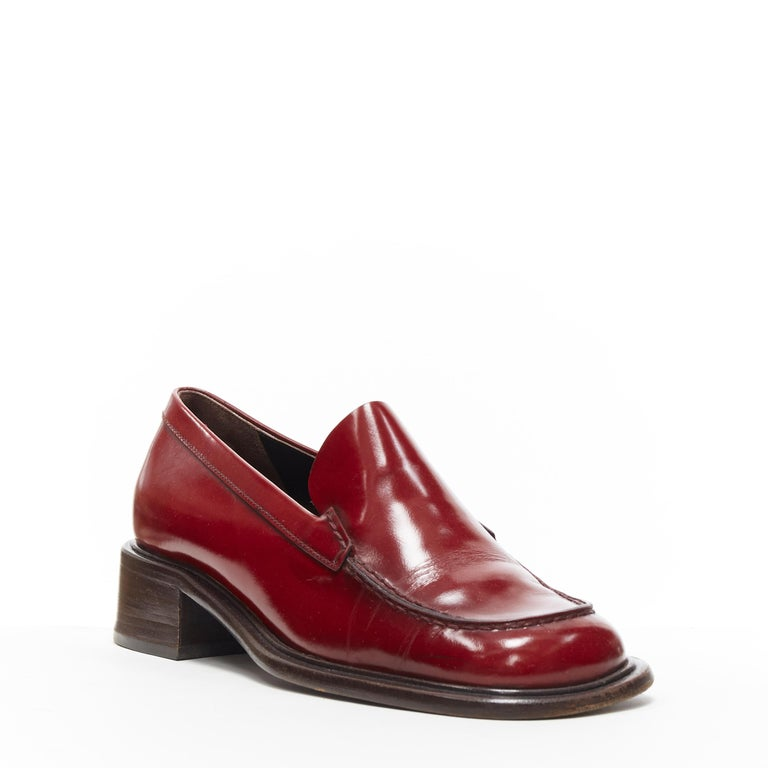 vintage PRADA red polished leather square toe chunky heel loafer EU34.5 Brand: Prada Designer: Miuccia Prada Model Name / Style: Loafer Material: Leather Color: Red Pattern: Solid Closure: Slip on Extra Detail: Mid (2-2.9 in) heel height. Square
