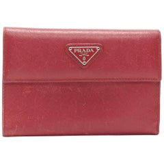 vintage PRADA red saffiano leather triangular plaque flap wallet