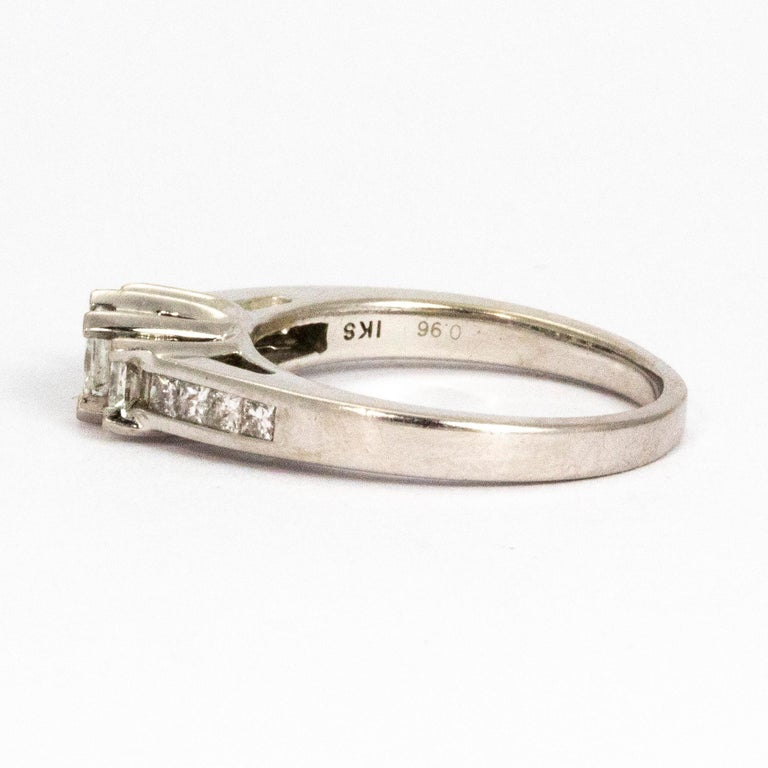 The sparkle of this ring is absolutely stunning! It holds three larger and more prominent princess diamonds which measure a total of 90pts and the shoulders also hold four smaller princes cut stones on each. The ring is modelled in platinum and the