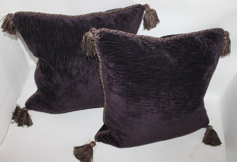 This fine dark purple pillows with gold fringe are in pristine condition and are velvet front and back. The inserts are down and feather fill.