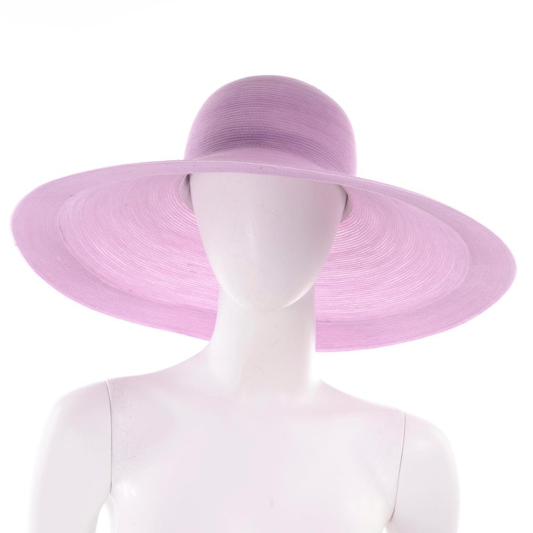 We love vintage Patricia Underwood hats! This one is a woven lavender sun hat with a wide brim, bearing the Patricia Underwood New York black label. This hat has a nice wide brim and you could tie a scarf or ribbon around it if you'd like to change