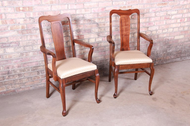 A gorgeous pair of Queen Anne mahogany armchairs. Perfect for dining captain chairs or club chairs.  Early 20th century  Measures: 22