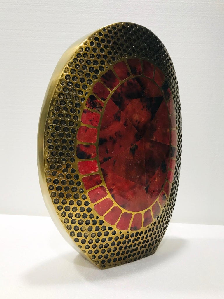 Large organic modern vase handcrafted in solid bronze metal with inlays of exotic pen shell. Heavy-set oval frame in textured bronze features a series of hammered circles reminiscent of reptile or snake scales. The mosaic centers on either side of