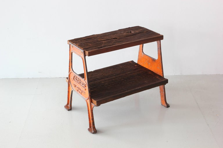 Great vintage railroad step stool with original orange painted steel frame and raw wood steps. Fantastic chipped paint on frame that reads