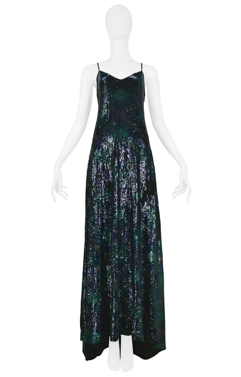 Vintage Ralph Lauren navy blue and forest green silk sequined argyle print evening gown with spaghetti straps that cross at center back and a slight train.  Excellent Vintage Condition.  Size 8