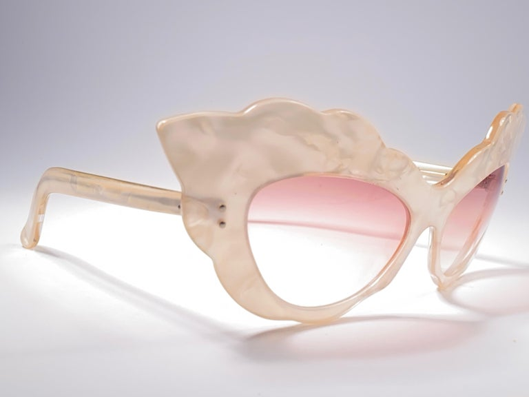 Seldom Vintage Rare Alain Mikli 1980 oversized cat eye acetate mother of pearl effect frame.  Light gradient lenses.  Please consider that this item is nearly 40 years old so it could show minor sign of wear due to storage.  Made in France.