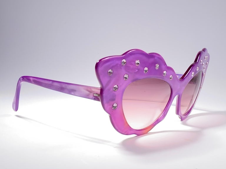 Seldom Vintage Rare Alain Mikli 1990's fuchsia oversized cat eye adorned with rhinestones frame.  Light gradient lenses.  Please consider that this item is nearly 40 years old so it could show minor sign of wear due to storage.  Made in France.