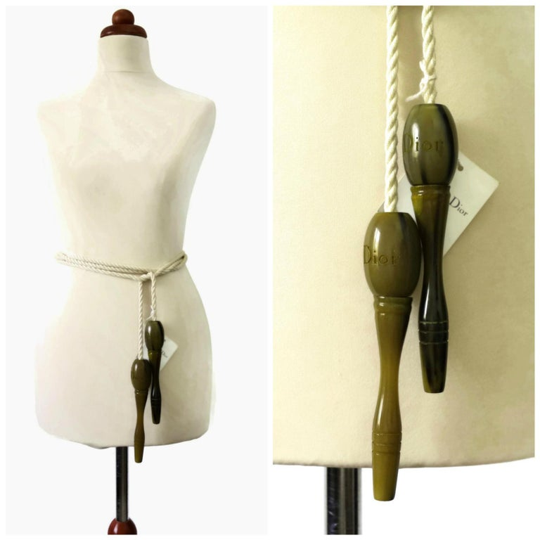 Vintage Rare CHRISTIAN DIOR Resin Jumping Rope Belt  Measurements: Handle Height: 6 2/8 inches Handle Width: 1 2/8 inches Length: 102 2/8 inches  Features: - 100% Authentic CHRISTIAN DIOR. - Marbled olive green handles with engraved DIOR on each. -