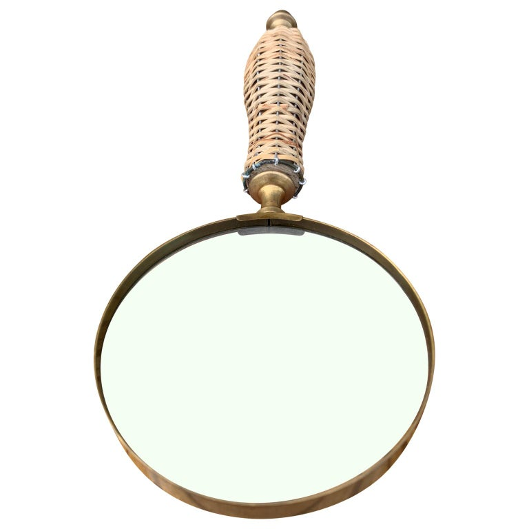 Vintage rattan and brass magnifying glass.