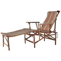 Vintage Rattan Armchair and Footrest with Green Woven Details, France, 1920s